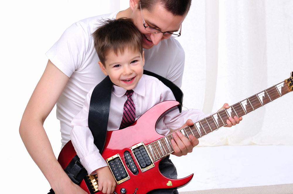 father-teaches-son-guitar_shutterstock_66502150